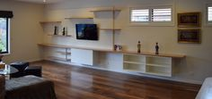 Spaceworks guarantees that our wall units, TV cabinets, entertainment and media units in Melbourne are the ideal solution for your electronics and accessories. Custom Floating Shelves, How To Make Floating Shelves, Timber Shelves, Media Unit, Tv Cabinets, Large Homes, Floor Cushions, Space Saving, Ideal Home