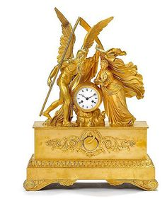 A large French Empire mantel clock. First half of the 19th c