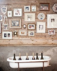 I like this idea a lot!  The bride hung family photos in vintage frames she had collected from thrift stores and yard sales on the wall of their reception space.