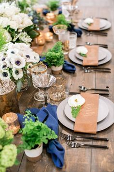 30 Rustic Wedding Centerpieces That Go Beyond the Basic Mason Jar - Yes, it IS possible to have a rustic wedding without mason jars — trust us. Say hello to these stylish rustic wedding centerpieces that are anything but overdone. rustic wedding tablescape with cobalt blue napkins, potted plants and gold details fall Chic Wedding, Wedding Table, Wedding Blog, Our Wedding, Dream Wedding, Wedding Color Schemes, Wedding Colors, Gay Wedding Flowers, Rustic Wedding Centerpieces