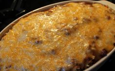 Ingredients  1 pound ground beef  garlic to taste  1 teaspoon salt  1 teaspoon sugar  2 cans (8-ounces) tomato sauce  8 ounces egg noodles  8 ounces sour cream  8 ounces cream cheese  1 1/2 cup Cheddar cheese, shredded    How to make this recipe        Source : allrecipes.Com