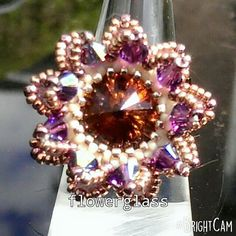 Check out this item in my Etsy shop https://www.etsy.com/uk/listing/237977789/swarovski-rivoli-and-bicone-flower-ring