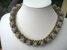 Woven spiral seed bead necklace in white black gold and von Cynarts