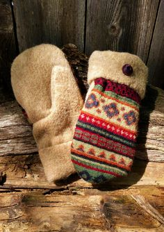 These handmade upcycled wool sweater mittens have a multi-colored pattern on the front and tan wool on the palm and cuff. They are lined in tan fleece and have a medium-sized brownish blue button detail. Sweater Mittens, Wool Sweaters, Teaching Art, Color Patterns, Knitted Hats, Upcycle, Knitting, Creative, Artwork