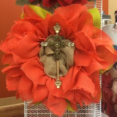 Peach burlap sunflower wreath with avocado green leaves and natural center with Spoons of Faith cross $75