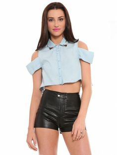 Chambray crop top featuring cutouts at the shoulder, a button up closure and silver tone hardware details on the collar