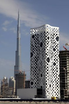 The 50 Most Innovative Buildings Of The Last Decade   O-14, Dubai, UAE. The one metre wide space between the facade and the glass windows allows the building to cool down in the desert heat. [Futuristic Architecture: http://futuristicnews.com/category/future-architecture/]