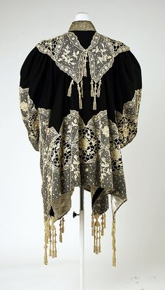 Coat (Dolman).  House of Worth (French, 1858–1956).  Date: 1905–10. Culture: French. Medium: wool, metallic thread. Dimensions: Length: 30 in. (76.2 cm). Width at Bottom: 97 in. (246.4 cm).