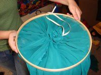 Make your own bed canopy... using an embroidery ring.