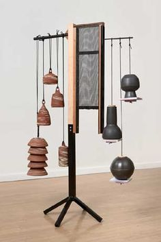 Ian McDonald.  HouseWearing (everything else)  2011  ceramic, wood, powder coated steel, screen, rope, cork  68 x 42 x 23 inches