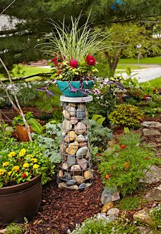 Elevate Your Container Garden With a Gabion Plant Stand The concept is simple: a wire cage filled with rocks. But the result is a natural and sturdy plant stand to raise up any garden container. Garden Yard Ideas, Diy Garden Projects, Garden Crafts, Garden Art, Garden Design, Bird Bath Garden, Diy Bird Bath, Tomato Cage Crafts, Tomato Cages