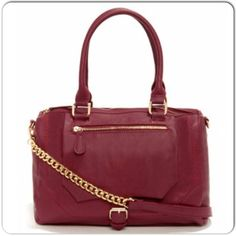 "HP8/1Burgundy Vegan Leather Convertible Bag NWT Nila Anthony Burgundy Convertible Bag. Vegan leather with gold-tone hardware. Back zip pocket and front pocket with large main zippered compartment. Option to also wear with detachable long strap on the shoulder or as a cross-body. Dust bag included. Measures approx. 13""x11""x5"". Nila Anthony Bags"