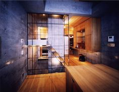 """""""Seven"""", a 5-level house in Tokyo, Japan has a striking interior combining raw concrete and refined wood finishes; designed by APOLLO Architects; photo by Tomonori Nakamura"""