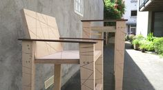 A stool and table stand by nitsn