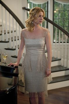 This dress looks amazing on film, the net material looks very delicate and sparkly. Emily van Camp as Emily Thorne on Revenge.