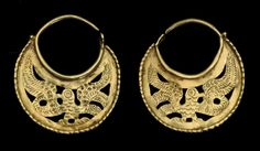 A PAIR OF BYZANTINE GOLD EARRINGS   CIRCA 6TH-7TH CENTURY A.D.   Of lunate openwork form, with the figure of an eagle with wings outstretched, with chased and punched decoration  1½ in. (3.7 cm.) wide max.