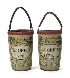 A PAIR OF PAINT AND POLYCHROME DECORATED LEATHER FIRE BUCKETS  NEWBURYPORT, MASSACHUSETTS, DATED 1776http://www.christies.com/
