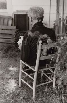 Joseph Cornell, sitting in a lovely chair.