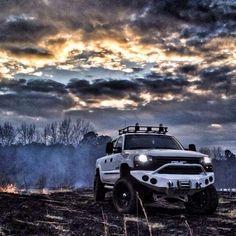 white lifted GMC Sierra Truck nice sunset