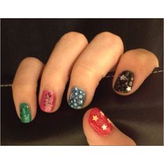 Taylor's manicure #2/theme: stars .....Used multi colored polish, konad stamping stars, star shaped rhinestones and confetti, and seche vite top coat. She loves having each nail a different color.