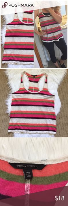"Banana Republic Linen Striped Tank Top Colorful racerback striped tank in linen. Great texture and relaxed fit. Ivory, orange, green, pink and eggplant stripes. Slightly sheer. Runs a little big. ▪️Size XS ▪️100% linen. ▪️18"" armpit to armpit flat across and 25"" shoulder to hem length. In good condition! Banana Republic Tops Tank Tops"