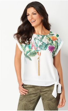 The perfect summertime look starts with this pretty textured blouse. It's designed with a tropical scene on the front, along with cute cuffed sleeves and a tie detail.
