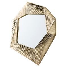 If origami is an art form then this irregular shaped mirror is an example of how one art form can influence and inspire another. The solid brass frame takes on the appearance of paper that has been fo