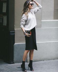 Street Style 2016/2017 Alex Rivièreis wearing an elegant black pencil skirt with a