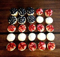 Get some cupcakes and decorate them with blueberries, strawberries and coconut.