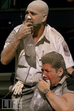 Paramedic and Cop, New York, September 11, 2001 -   The look on their faces. Will never Forget