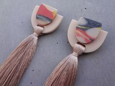 A personal favorite from my Etsy shop https://www.etsy.com/au/listing/527666690/stacked-tassel-earring-cocktail-tassel