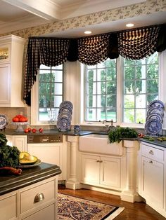 The black and  white checked fabric keeps this swagged window treatment from being too fussy for a kitchen.