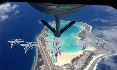 Air Force Stratotanker refueling aircraft from the Kansas Air National Guard's Air Refueling Wing prepares to refuel Navy Hornets over Wake Island during an escort mission from Japan to the United States. Fighter Aircraft, Fighter Jets, Wake Island, Bomber Plane, Islands In The Pacific, Art Of Manliness, Staff Sergeant, Military Photos, Military History