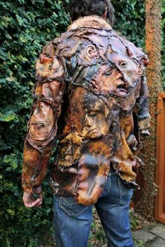 Texas Chainsaw Massacre style leather jacket made to look like human faces and skin.