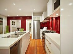 Eye Catching Galley Kitchen Ideas Exposing White Island and Red