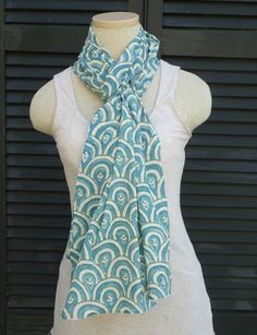 """Scarves are travel essentials. This pattern is called """"the peacock"""". This light-weight cotton hand block printed fair trade teal scarf is an easy way to dress up a white t-shirt. Hand block stamped with natural, plant based dyes, 100% Vegan & made in India."""