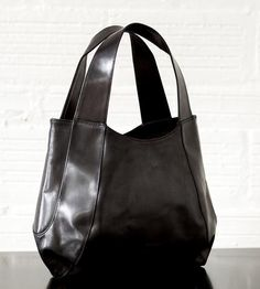 Jessica Leather Tote | One can stow a goodly amount of things in this tote –– which i... | Tote Handbags