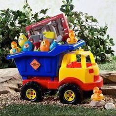 Toddler Easter basket idea! Take a toy dump truck and fill it with toys, tools, rubber duckies, plastic Easter eggs, and Easter grass. Neat!