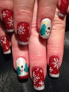 Gel nails with hand painted snowflakes and snowmen