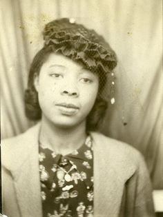 A Young Lady In Contemplation.This is an old photograph of a young African American woman that was  made in an automatic photo booth. There is nothing to identify what  this young lady's name was or when or where the photograph was taken.  Judging by her clothing and her hairstyle, this photograph was likely  taken sometime during the late 1940's or early 1950's.
