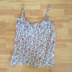 Floral cami Adjustable straps and ruffle detail along the top of the front and back. Buttons go down the top half of the front. Fabric is slightly sheer. Super cute and feminine summer top. Worn only once or twice and in excellent condition. Cotton On Tops Camisoles