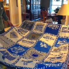 Cool UK tshirt quilt. I soooooo want this @Cathy Moberly we were just talking about a t-shirt quilt