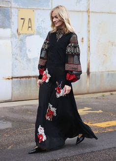 Bohemian peasant top with mixed prints layered under an embroidered maxi dress and kitten heels.