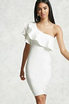 A knit mini dress featuring a one-shoulder design, a flounce that falls into a layered short sleeve, and a bodycon silhouette.