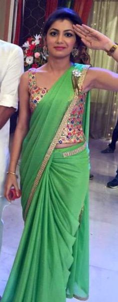 So cute green saree and design er blouse