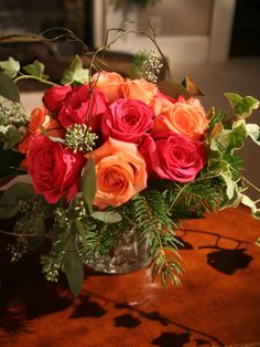 Trisha Yearwood's Simple Southern Christmas:   Evergreen foliage and roses in warm tones provide a palette that's both fresh and inviting. Some of the greenery was gathered from Trisha's own backyard.