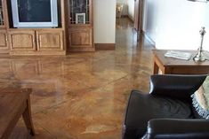 Stained concrete offers creative method of imparting color onto gray concrete floors. Photo: General Concrete Finishers ...