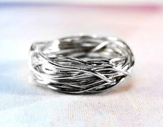 This ring is comfortable to wear as the silver wire is smooth and also very shiny. The advantages of artisan crafted rings are that they take