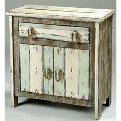 Ships Mid August Reserve Your NowThis driftwood two door cabinet is made of solid pine-mdf with a driftwood, distressedfinish alternating colors of grey/sky blue/white. Accent with rope for that look and feel of coastal driftwood. This coastal 2 door cabinet can accent any room in your beach home.See matching 4 drawer chest.32.3