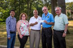 PDG John Kobland, a MD-16 District Project Chair for the Sandy Disaster Relief Committee, presents a check for $15,000 from an LCIF MCAT grant for Sandy relief to Faith and Trade Helping Hands on Sept. 2, 2014. FAT Helping Hands is partnering with Middlesex County Long-Term Recovery Group to help victims in 9 towns in Middlesex County with Sandy relief efforts.